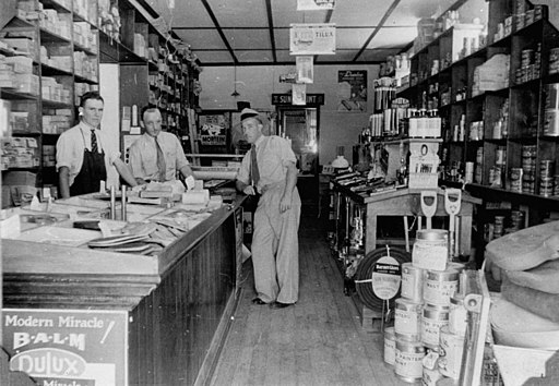 StateLibQld 2 184151 Over the counter at the Downs Hardware Store, Dalby, 1937