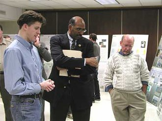 Michael Steele - Steele watches a video and discusses Seaduck Research with Edward Lohnes (left) and Dr. Matthew C Perry (right)