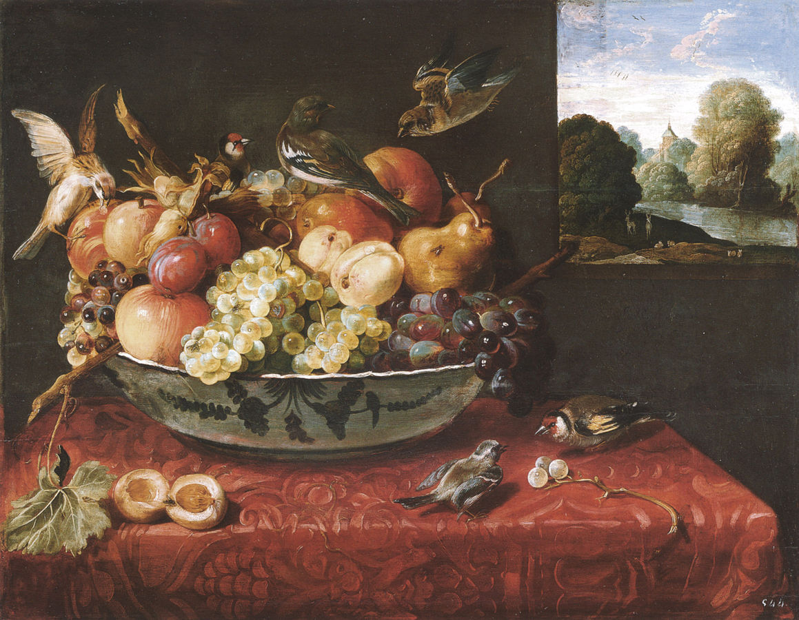 Still life with fruit bowl on a table and view of a landscape through an open window