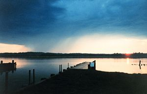 Sunset and a small rain storm across the river - NOAA.jpg