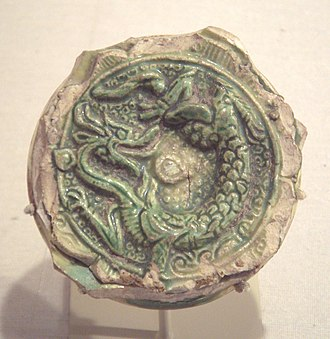 Chinese influences on Islamic pottery - Tang Dynasty earthenware fragment with sancai glaze, end of 7th-early 8th century, excavated in Nishapur, Iran.