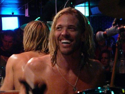Long-time drummer Taylor Hawkins (pictured in 2012) joined the band in 1997 TaylorHawkins.jpg