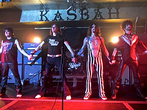 The Darkness discography - A former lineup of The Darkness in 2013. From left to right: Ed Graham, Dan Hawkins, Justin Hawkins, Frankie Poullain.