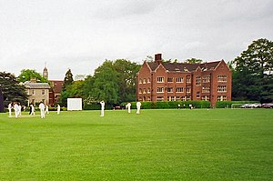 The Leys School - The Stamp Building (right) comprising East House, Moulton Day House, and the Modern Languages Department, with the Headmaster's House (left) and the Chapel behind.