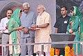 The Prime Minister, Shri Narendra Modi distributing the Cards for free medical treatment at Shri Mata Vaishno Devi Narayana Hospital, at Katra, in Jammu and Kashmir (2).jpg