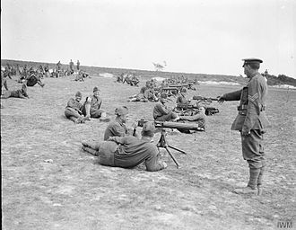 39th Division (United Kingdom) - Machine gunners of the U.S. 77th Division during training under the 39th Battalion, Machine Gun Corps, British 39th Division, near Moulle, France, 22 May 1918.
