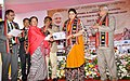 The Union Minister for Textiles, Smt. Smriti Irani distributing the 'Pehchan' Identity Cards to the artisan, at the inauguration of the Apparel and Garment Making Centre, in Imphal, Manipur on November 27, 2016.jpg