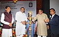 """The Union Minister for Tribal Affairs, Shri Jual Oram lighting the lamp to inaugurate the National Workshop on """"Minimum Support Price (MSP) for Minor Forest Produces (MFP) scheme - Taking it to the next level"""", in New Delhi.jpg"""
