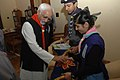 The cadets of Bharat Scouts and Guides collecting funds from the Vice President, Shri Mohd. Hamid Ansari on the occasion of foundation of Bharat Scouts and Guides, in New Delhi on November 07, 2008.jpg
