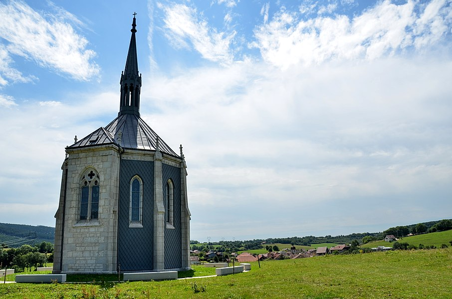 The chapel Notre Dame des Anges at Ouhans (the village can be seen in the background) Jura