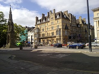 Macdonald Randolph Hotel - General view of the Randolph Hotel, looking southwest from the southern end of St Giles' Street, with the Martyrs' Memorial on the left.