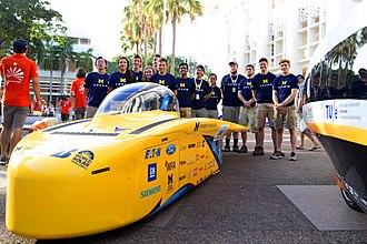 University of Michigan Solar Car Team - The team poses for a group photo at the Bridgestone World Solar Challenge '17 starting line