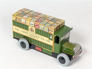 Chad Valley (toy brand) - A tin-plate Chad Valley toy truck, displaying their royal warrant.