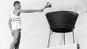 1961 Maccabiah Games - Israeli runner Yoseph Lahav lighting the cauldron at the Opening Ceremony.