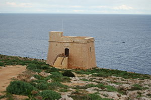 Sopu Tower - The tower as seen from land, with the sea in the background