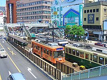 Trams with traffic - Nagasaki.jpg