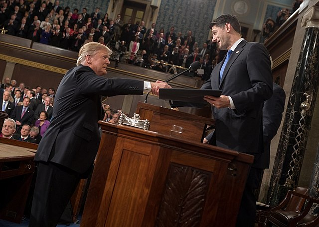 From commons.wikimedia.org: Trump shaking hands with Paul Ryan {MID-243389}