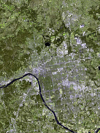 As seen from space, most of Tulsa lies east of the Arkansas River. Tulsa satellite poster edit1.jpg