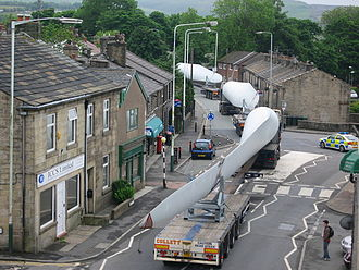 Wind turbine - A turbine blade convoy passing through Edenfield, England