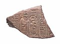 Two-sided curved element with names of Akhenaten and Nefertiti on both sides MET 57.180.55 view 1.jpg