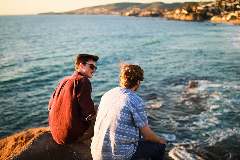 File:Two guys on Laguna Beach rocks (Unsplash).jpg