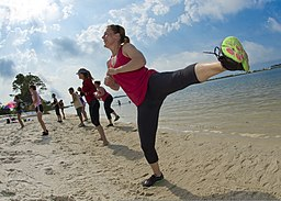 U.S. Air Force Chief Master Sgt. Karen Thomas, foreground, the superintendent of the 1st Special Operations Force Support Squadron, side kicks during beach boot camp on Soundside Beach at Hurlburt Field, Fla 130518-F-RS318-015