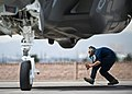 U.S. Air Force Senior Airman Alexander Orchard, a crew chief with the 57th Aircraft Maintenance Squadron, crouches underneath the exhaust of an F-35A Lightning II aircraft April 4, 2013, at Nellis Air Force 130404-F-KX404-074.jpg