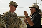 U.S. Army Maj. Gen. Kenneth Dowd, left, the director of logistical operations for the Defense Logistics Agency, speaks William Davidson, a yard chief with Defense Logistics Agency Disposition Services at Bagram 130627-A-ZT122-105.jpg