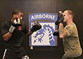 U.S. Army Sgt. Jonathan McKenzie, left, practices punch drills with Staff Sgt. Luis Zayas, both combatives instructors with XVIII Corps, in preparation for an exhibition match in the 2013 Fort Bragg Army 131210-A-PX124-005.jpg