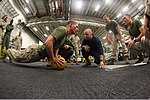 U.S. Marine Corps Lance Cpl. Brandon Harris, left foreground, with the command element of the 24th Marine Expeditionary Unit, participates in the combat conditioning portion of the Warrior of the Month event 120501-M-RO494-136.jpg