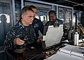 U.S. Navy Aviation Electronics Technician 3rd Class Wade Henderson, left, Aviation Support Equipment Technician 2nd Class Anthony Guzman, center, and Chief Warrant Officer George Hanna, all assigned to 130525-N-IY633-009.jpg