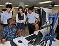 U.S. Navy Quartermaster Seaman Apprentice Byron Johnson, seated, explains how the Voyage Management System works to interns from the South Korean Parliament at Operations Specialist-Quartermaster A School at the 120730-N-IK959-198.jpg