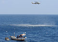 U.S. Sailors assigned to guided-missile cruiser USS Vella Gulf (CG 72), under way in the Gulf of Oman, Feb. 7, 2009, use a rigid-hulled inflatable boat to approach a dhow that needs assistance 090207-N-RT317-058.jpg
