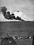 USS Belleau Wood (CVL-24) burning after she was hit by a Kamikaze off Luzon, Philippines, 30 October 1944.jpg