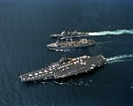 USS Kansas City (AOR-3) replenishes USS Ranger (CV-61) and USS Valley Forge (CG-50) in the Pacific Ocean on 28 March 1991 (6483825).jpeg