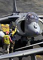 US Navy 030318-N-6610T-511 An AV-8 Harrier pilot gets a fuels update before taking off from the flight deck of the USS Bataan (LHD 5) in support of Operation Iraqi Freedom.jpg