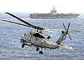 """US Navy 030423-N-3235P-503 An SH-60 """"Seahawk"""" assigned to the Dusty Dogs of Helicopter Anti-submarine Squadron Seven (HS-7) makes its way back to the flight deck aboard USS Harry S. Truman CVN-75.jpg"""