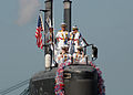 US Navy 031031-N-5376G-007 Crewmembers aboard USS Pasadena (SSN 752) scan the pier for family and friends as the fast attack submarine returns to its homeport of Pearl Harbor, Hawaii.jpg