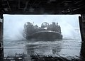 US Navy 031207-N-9195K-002 Landing Craft Air Cushion (LCAC) seventy two assigned to USS Peleliu (LHA-5), pulls back into the well deck after operations were suspended due to rough seas.jpg