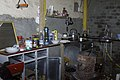 US Navy 031217-A-0000X-002 A modest array of items sits inside the makeshift kitchen where Saddam Hussein probably ate his last meal before his capture.jpg
