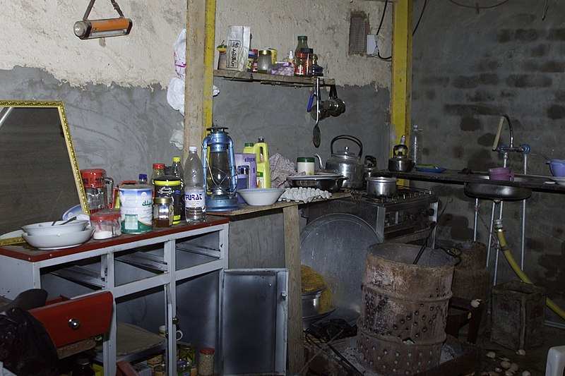 File:US Navy 031217-A-0000X-002 A modest array of items sits inside the makeshift kitchen where Saddam Hussein probably ate his last meal before his capture.jpg