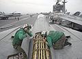 US Navy 040427-N-3986D-016 Sailors repair antenna wiring in the turtle back of an F-14B Tomcat.jpg