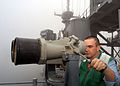 US Navy 040615-N-1512S-025 Aerographer's Mate Airman Travis Strait scans the horizon on binoculars while he stands a low visibility detail.jpg