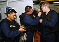 US Navy 040623-N-4374S-001 Sailors assigned to the Visit Board Search and Seizure (VBSS) team aboard the guided missile cruiser USS Vicksburg (CG 69) inspect their gear as they prepare to conduct a Maritime Interception Operati.jpg