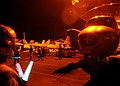 US Navy 040713-N-8704K-001 During night time combat missions in support of Operation Iraqi Freedom, plane captain spots an E-2C Hawkeye assigned to the Tigertails of Airborne Early Warning Squadron One Two Five (VAW-125) aboard.jpg
