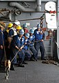 US Navy 050106-N-9214D-092 Sailors assigned to 1st Division aboard USS Bonhomme Richard (LHD 6) heave around the line to receive relief supplies from the Military Sealift Command (MSC) underway replenishment oiler USNS Tippecan.jpg