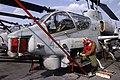 US Navy 050125-N-8668H-021 Marine Sgt. Vaughn Sellers works on a AH-1W Super Cobra helicopter assigned to the White Knights of Marine Medium Helicopter Squadron One Six Five (HMM-165), on flight deck aboard USS Bonhomme Richard.jpg