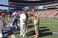 US Navy 050213-N-9076B-043 Commander, U.S. Pacific Command, Adm. Thomas Fargo shakes the hand of a Purple Heart recipient prior to the kickoff of the 2005 NFL Pro Bowl in Honolulu, Hawaii.jpg