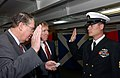 US Navy 050324-N-8148A-027 Rep. Randy Duke Cunningham (R-CA), left, and Bill Irish Driscoll, center, take part in the reenlistment ceremony aboard USS Ronald Reagan (CVN 76).jpg