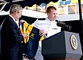 US Navy 050527-N-5390M-193 A graduating Midshipman presents U.S. President George W. Bush with a Naval Academy windbreaker jacket, during the 2005 Naval Academy Graduation Ceremony.jpg